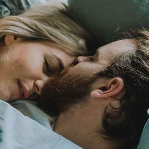 Antisnoring Mouthpiece: Couple waking after Peaceful Nights Sleep